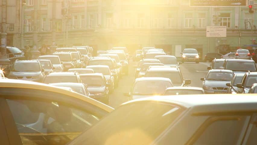 City traffic jam dusk sunlight cars stuck street, light movement