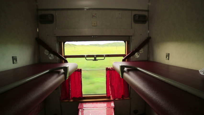 Empty sleeping class trans siberian train compartment, passing from mongolian vast grassland