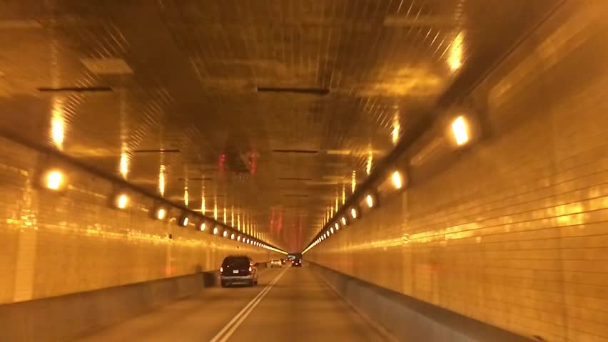 A driver's perspective of traveling through the Fort Pitt Tunnel in Pittsburgh,
