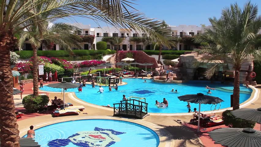 Hotel pool with people  EGYPT, SOUTH SINAI, SHARM EL-SHEIKH, SEPTEMBER 22, 2010: People ...