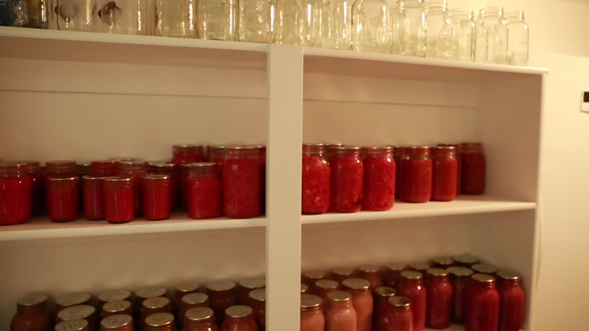 Food Canned In Mason Jars On Shelves In A Storage Room In The Basement   HD