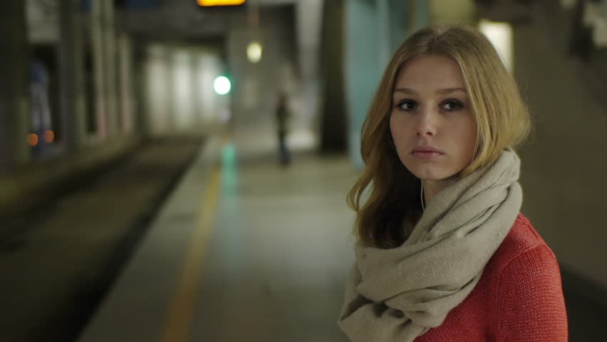gorgeous model waiting for her ride underground station beautiful face lighting