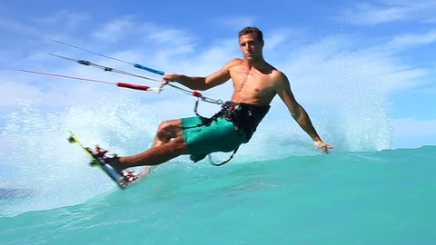 Young Man Kite Surfing In Ocean, Extreme summer sport in slow motion
