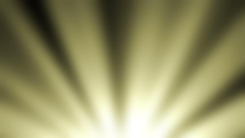 Golden glitter of light from the bottom of frame