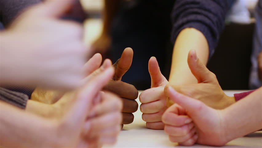 Teenager holding many thumbs up on a table (Full HD) | Shutterstock HD Video #5205908