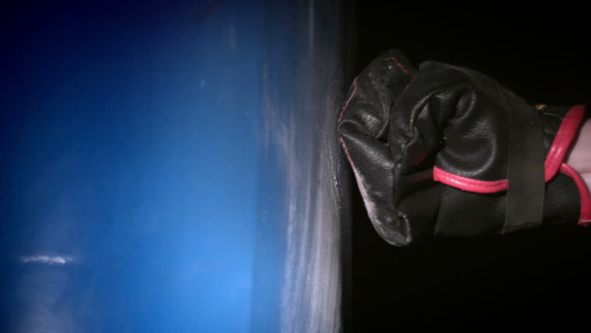 Punching boxing bag with glove