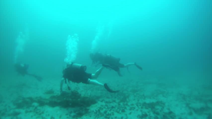 scuba divers over sandy rock pacific ocean mexico friends scuba dive off coast of puerto