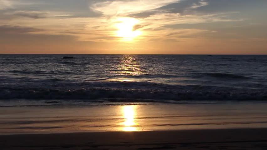 ocean beach at sunset, small waves, Ngwe Saung Beach, Myanmar(Burma)