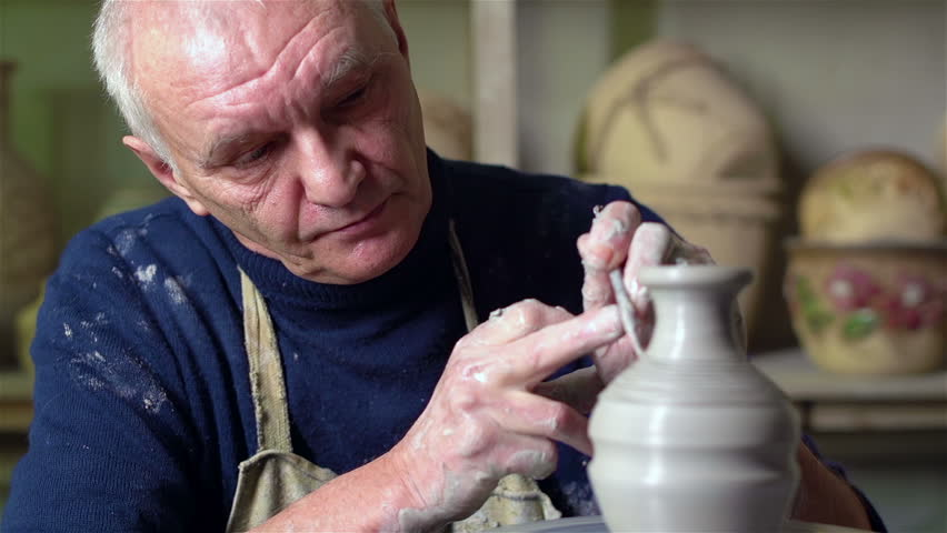 Experienced potter creating a beautiful clay vase using professional tools