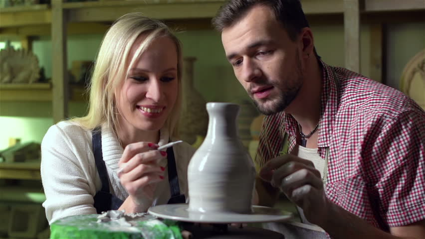 Young couple expressing their creativity in a pottery workshop