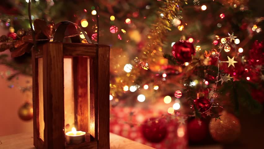 Magic Christmas Lights - Video clip of Christmas lantern with magical lights of Christmas tree in the background.