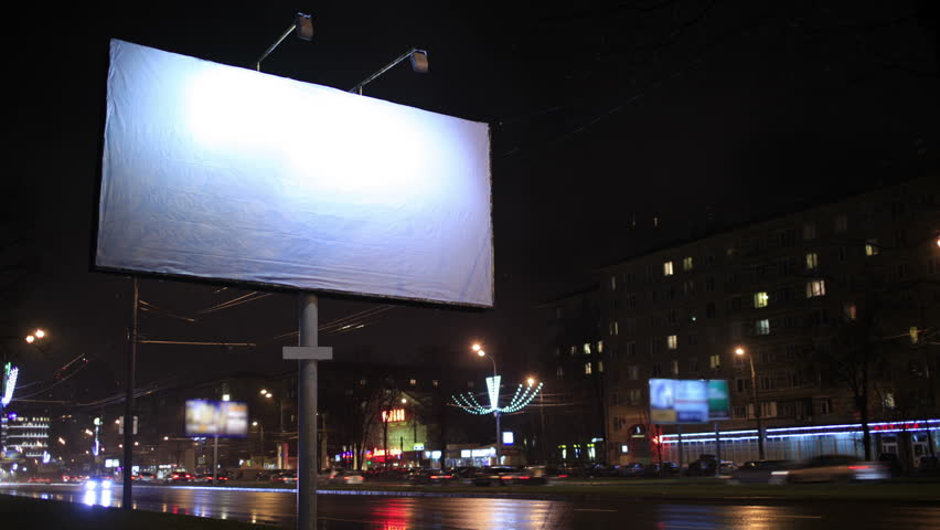 4K footage of Time lapse urban scene with an illuminated empty billboard on the side of a street with cars in motion and a block of flats in the background, by night | Shutterstock HD Video #5284853