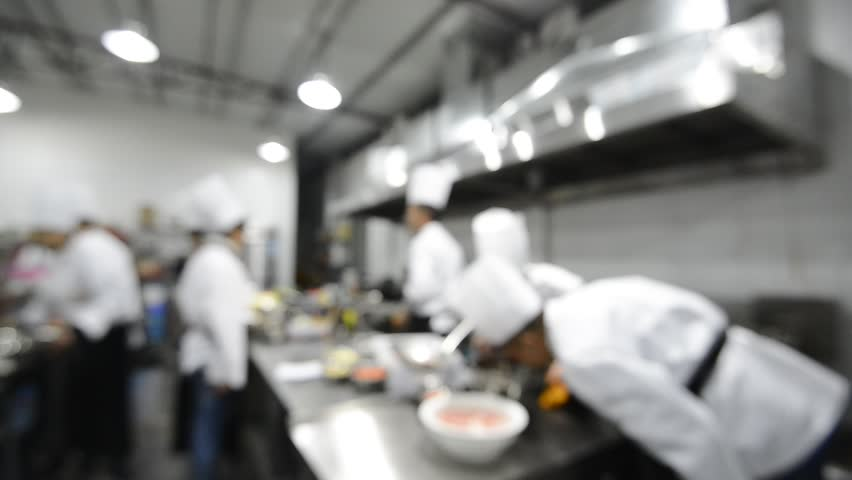 Blur Background Chefs Cooking Food In A Restaurant