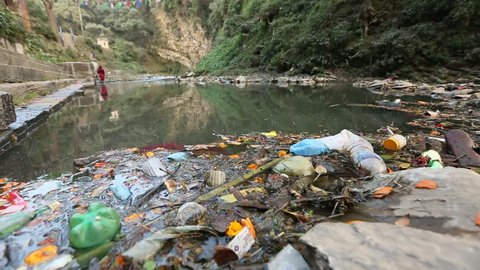 Environmental pollution in the Himalayas. Garbage in the water of river Bagmati. Environmental problems in the Himalayas. (HD)