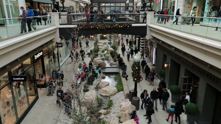 SALT LAKE CITY, UTAH DEC 2013: Luxury urban city mall attracts shoppers during Christmas and Holiday season. Economic boost and stimulus when economy is struggling and unemployment high time lapse.