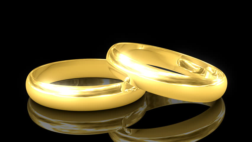 Two Golden Wedding Rings With Reflection Isolated Black