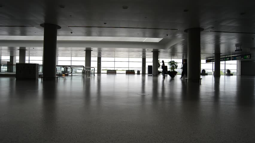 Shanghai - Jun 10,2013: (Timelapse View) People moving in the Pudong Airport on