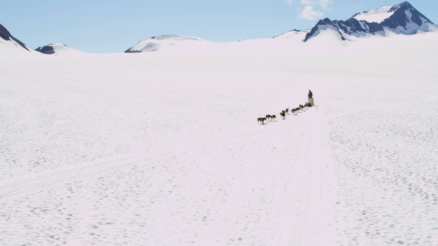Aerial view of husky dog team traversing snow covered high mountain plateau, Alaska, USA, RED EPIC, 4K, UHD, Ultra HD resolution