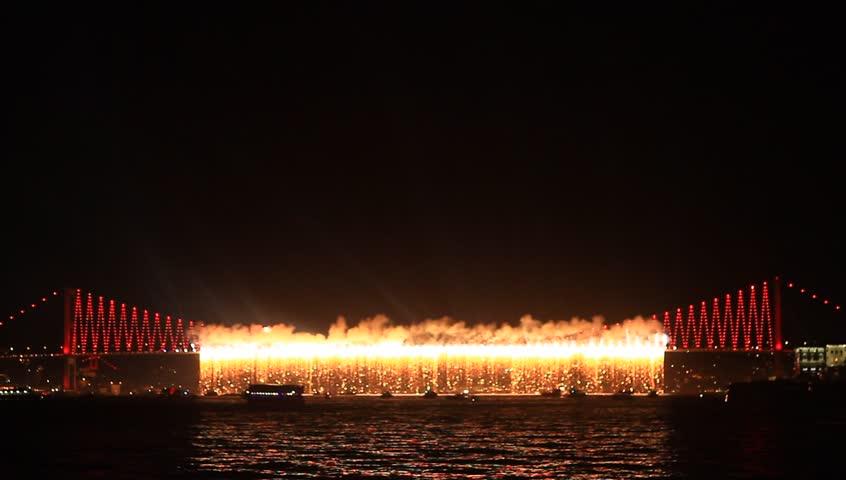 Firefall show on Bosporus Bridge. Firework show starts on the Bosphorus Bridge