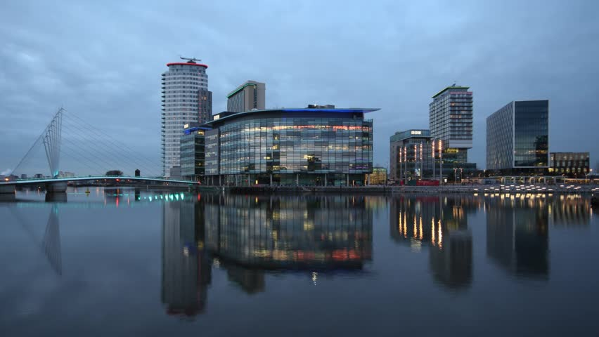 Day to Night Timelapse across the River Irwell of the new BBC buildings at MediaCity, Salford Quays, Manchester