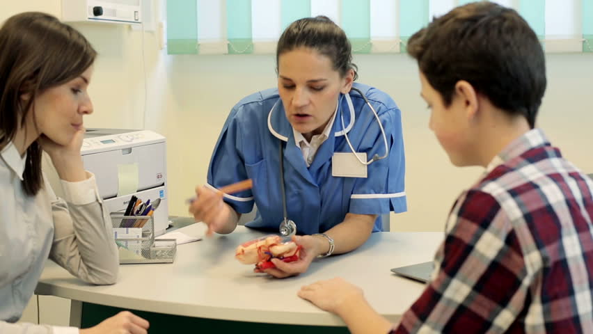 Doctor Checking Little Boys Glands In Her Office At The Hospital Stock Footage Video -4761