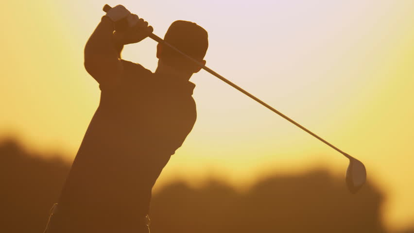 Sunset silhouette weekend male golfer enjoying time golf course in summer driving off down fairway upper body shot on RED EPIC, 4K, UHD, Ultra HD resolution | Shutterstock HD Video #5337083