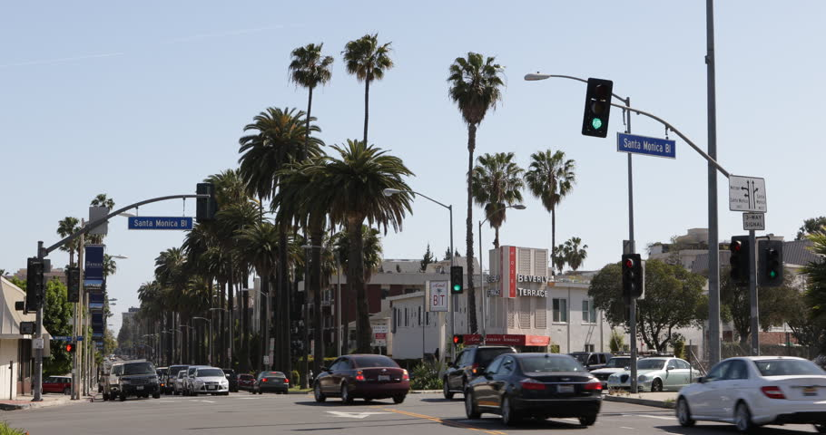 LOS ANGELES, USA - APRIL 15, 2013 Car Traffic in Beverly Hills, Palm Trees, Santa Monica BLVD, Los Angeles, USA ( Ultra High Definition, Ultra HD, UHD, 4K, 2160P, 4096x2160 )