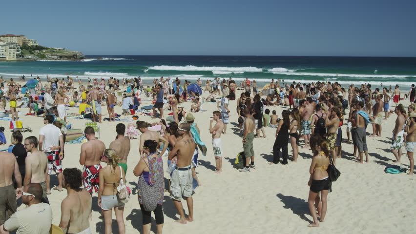 SYDNEY, AUSTRALIA - OCT 2009: Sun Seekers at Bondi Beach