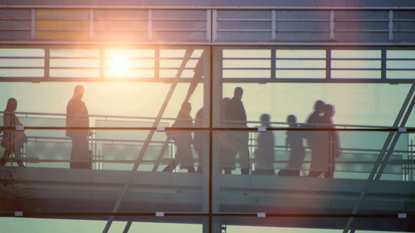 glass hallway. group team together. crowd of people. sunset sun flare. HDV