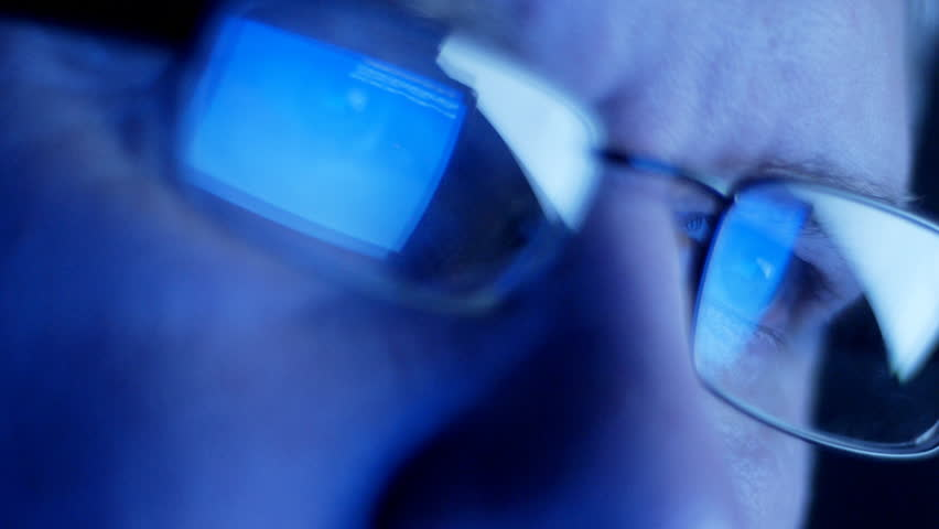 Computer screen and code reflected in man's glasses | Shutterstock HD Video #5379884