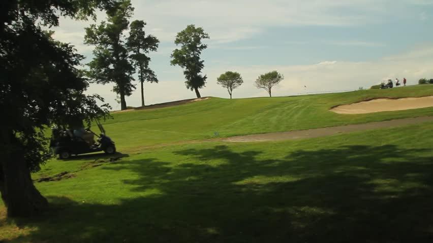 Golf cart driving near club house (1 of 2)
