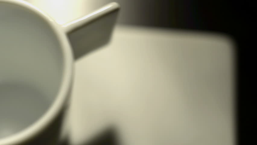 White cup on dark table