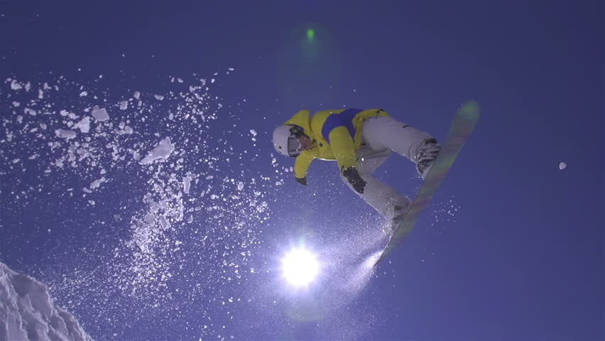 SLOW MOTION: Snowboarder jumps the kicker | Shutterstock HD Video #5412383