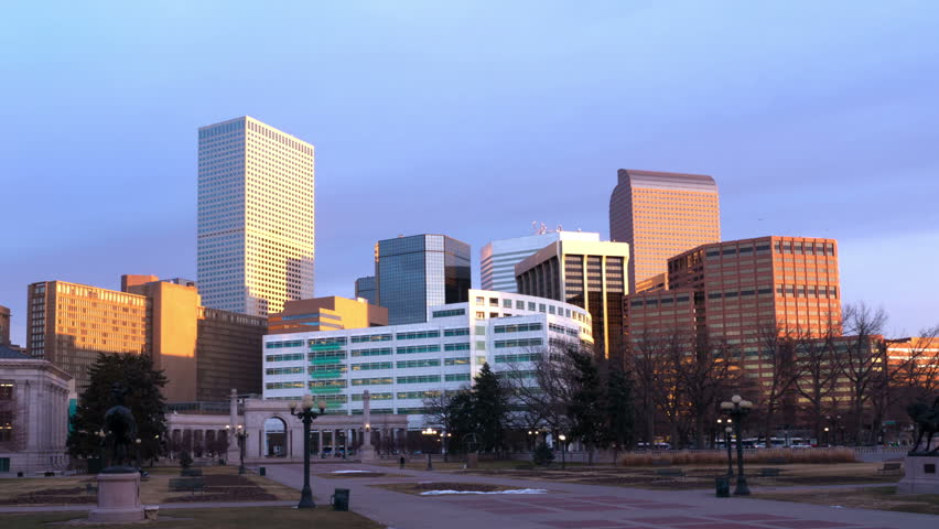 Morning sunlight reflects off skyscrapers in downtown Denver Colorado. HD 1080p time lapse. Corporate logos removed.