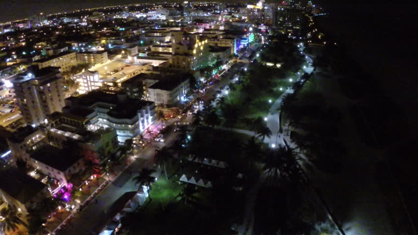 Aerial footage of Ocean Drive in Miami Beach Florida at night