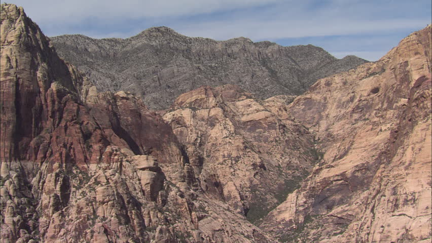 Las Vegas Desert Mountains. Aerial footage of the mountains and the desert surrounding Las Vegas. Steep red cliffs are raised over the desert.   Shutterstock HD Video #5475518