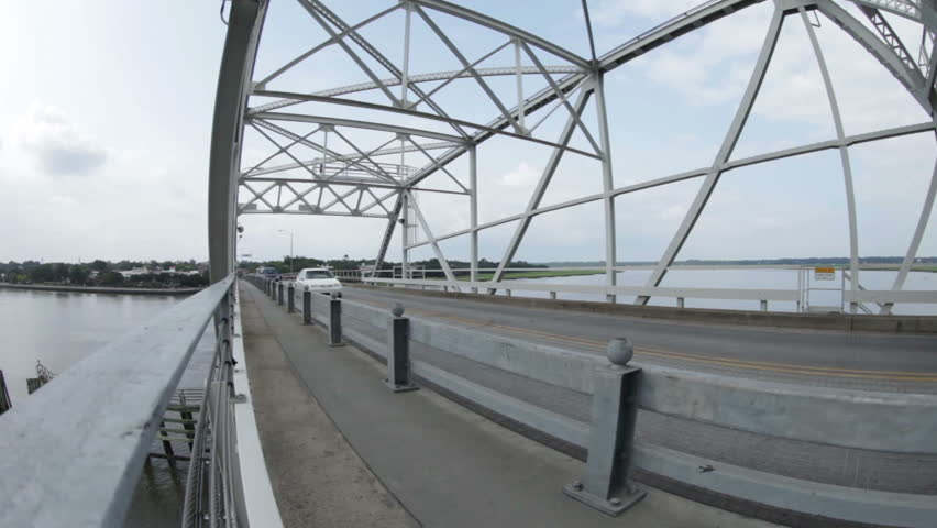 wide angle video of traffic passing on bridge #5476373