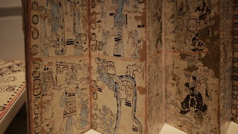 """MEXICO CITY, CIRCA JANUARY 2014: Close-up Mayan writings and drawings on papyrus in exhibition of pre columbian cultures in the exhibition """"Mayas Revelacion de un Tiempo Sin Fin"""""""