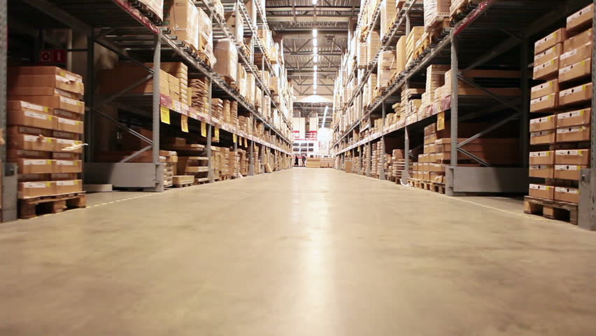 Camera moving between palettes with ordered goods and materials at warehouse