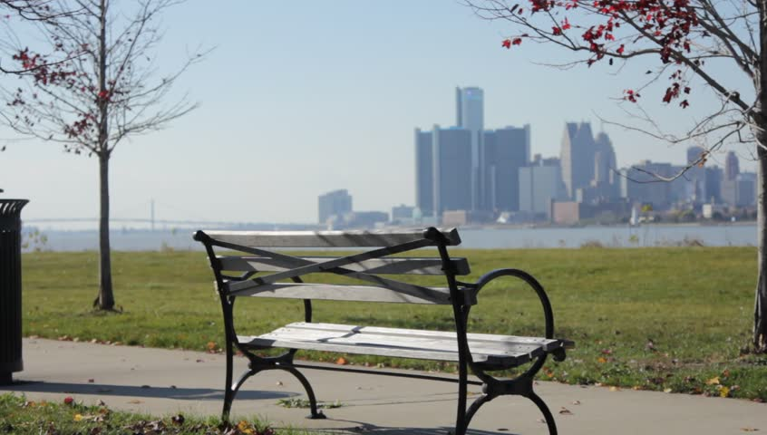 Pan of Park Bench with Skyline of Detroit from Across the Lake