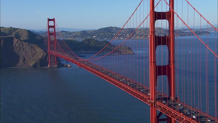San Francisco Golden Gate Bridge. The scene shows the city of San Francisco. A beautiful view of a busy Golden Gate bridge and city. The shot focuses on the traffic on the bridge.