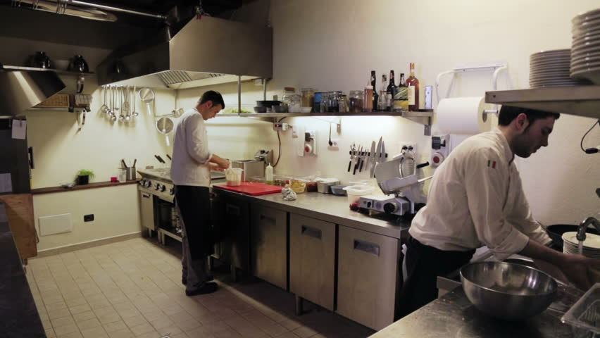 Restaurant Kitchen Video male chef in hotel or restaurant kitchen working and cooking meat