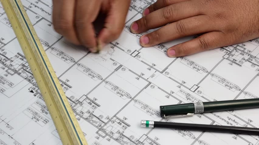 Hand drawing business plan with penpencil and ruler on the table an asian thai architect hand is deleting part of his drawing in his architect plan blueprint malvernweather Image collections