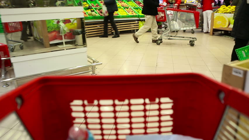 Moving shopping cart in big market. Fruit department | Shutterstock HD Video #5559293