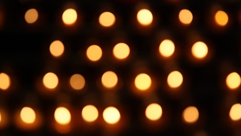 Blurred candles with flames   Shutterstock HD Video #5561450