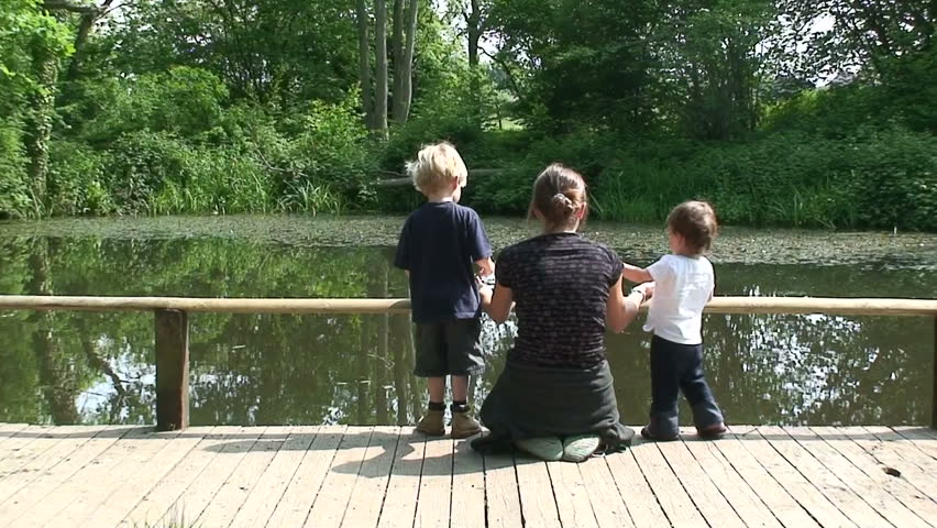 Mum and kids by lake