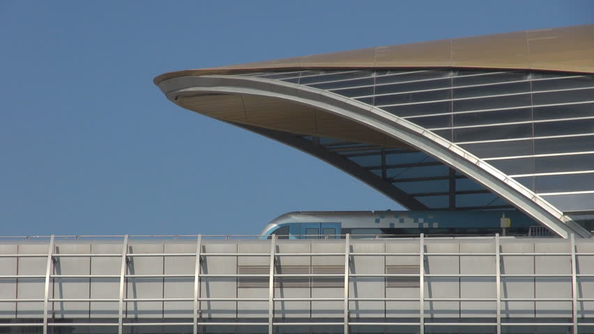 DUBAI, UAE - JANUARY 25, 2014,  Closeup, detail of metro station with est of wagon train by day