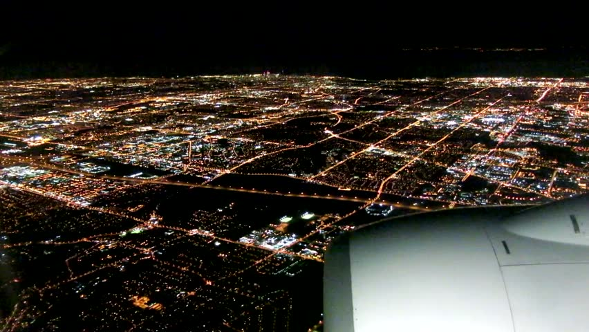 Flight Approaching City by Night