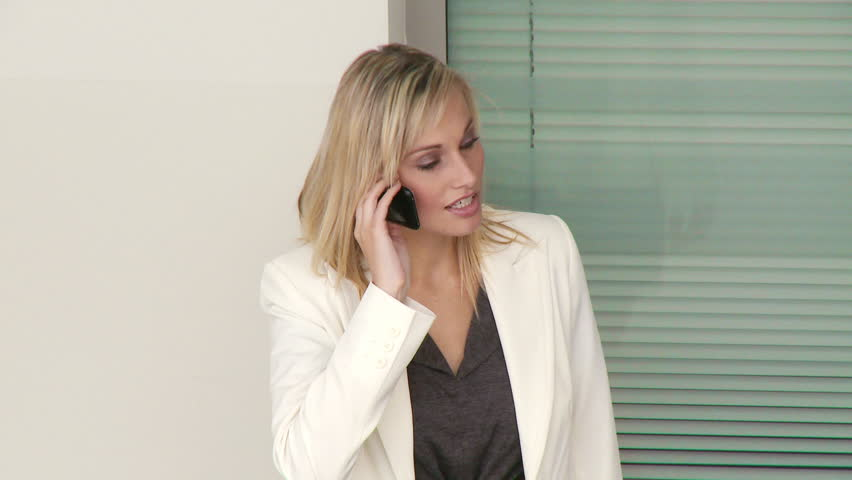 Attractive businesswoman on phone in workplace  | Shutterstock HD Video #559915