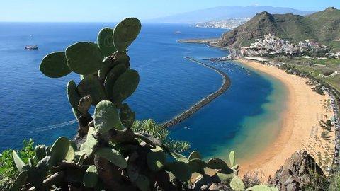 Teresitas beach aerial view dolly shot. Teresitas is white sand beach located in Santa Cruz De Tenerife In 1973, 270,000 tons of white sand was shipped from Sahara to create this artificial beach.